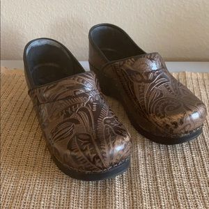 Dansko brown patterned clogs